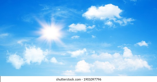 Sunny day background, blue sky with cumulus clouds and summer or spring sun as nature background. - Shutterstock ID 1901097796