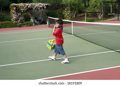 Sunny day, boy on the tennis court