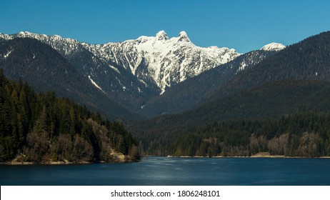 A sunny day at Capilano Lake. North Vancouver, BC, Canada.