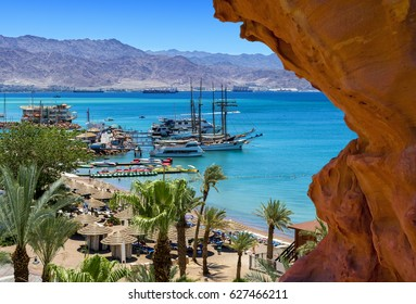 Sunny day at central public beach and marina in Eilat - famous international resort city in Israel