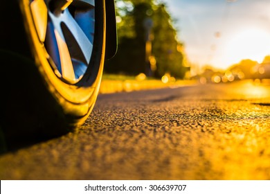 Sunny day in a city, headlights of approaching cars, the view from the road level from the wheel of the car