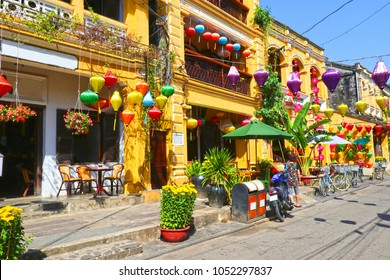 Sunny day at Hoian Ancient town, colourful houses. Colourful buildings with festive silk lanterns. UNESCO heritage site. Vietnam