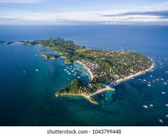 Sunny Day in Malapascua Island in Visayan Sea, One of Cebu Island. Sea water and Boats. Bounty Beach with Local Architecture