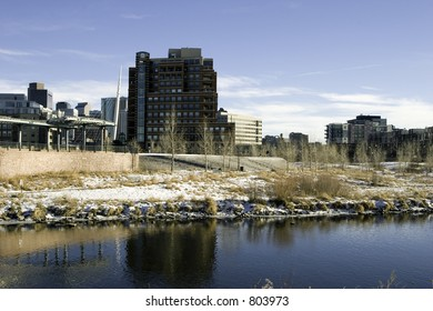 A sunny day melts some snow in downtown Denver, Colorado