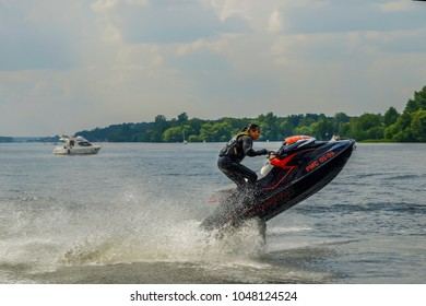 Sunny  day Near  Moscow Driver  lift  PWC  and  many  splash flying  difference  directions  JUNE  09  2013. Moscow Russia.