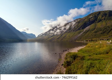 Sunny day in Norway. Green valley in Norway mountains. Beautiful landscapes and mountain lake.