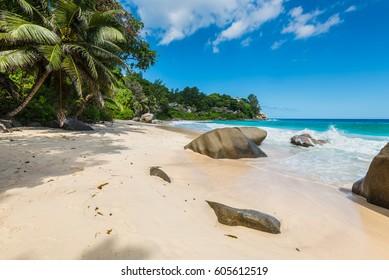 Sunny day on Anse Carana Beach in the north of Mahe, Seychelles