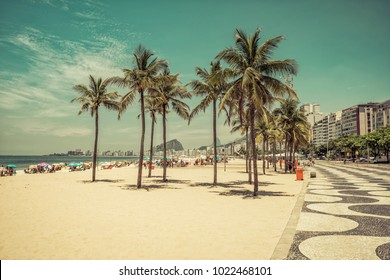 Sunny day on Copacabana Beach with palms in Rio de Janeiro, Brazil. Vintage colors