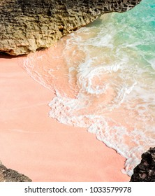Sunny day on a pink, sandy, tropical beach with turquoise ocean on the South Shore in Warwick, Bermuda.