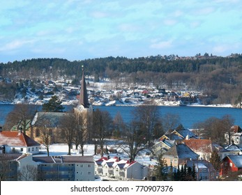 sunny day over a snow-capped city. View from above. Larvik, Norway.