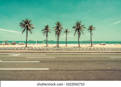 Sunny day with Palms on Ipanema Beach in Rio de Janeiro, Brazil. Wide angle view