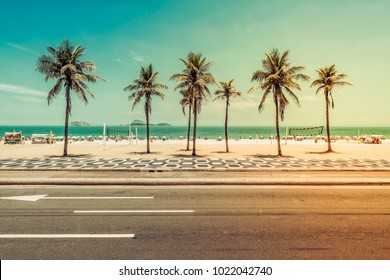 Sunny day with Palms on Ipanema Beach in Rio de Janeiro, Brazil. Light leak applied