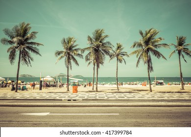 Sunny day with Palms on Ipanema Beach in Rio De Janeiro, Brazil. Vintage colors