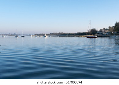Sunny day with Sailboats anchored in the port of Conleau in the Morbihan. Brittany. France
