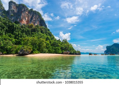 a sunny day in the tropics, a beautiful view of the sea and the rocky islands of Thailand. Boats on the sand spit