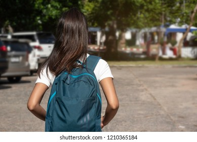 In sunny day,At university teenager woman studen walk in busy emotion,time late to study.