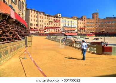 Sunny dirt track being prepared for Palio horse race in Piazza del Campo, Siena, region of Tuscany, Italy