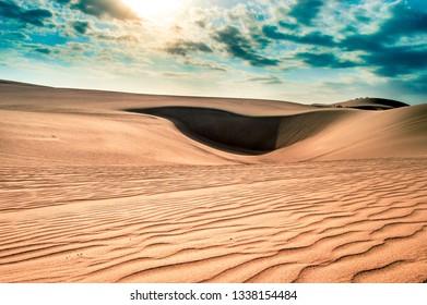 Sunny dunes in Huacachina - Peru