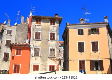 Sunny facades of traditional buildings of Venetian town near the Adriatic sea, Rovinj, Croatia