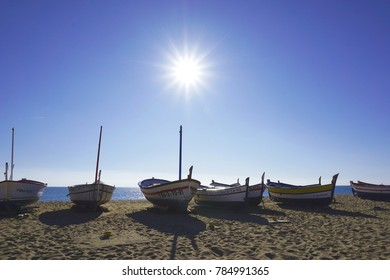 Sunny fishing boat images captured at the beach of Calella, Barcelona