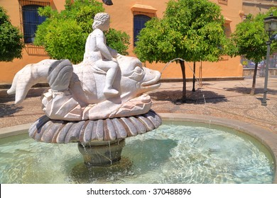 Sunny fountain and statue in Cordoba, Andalusia, Spain