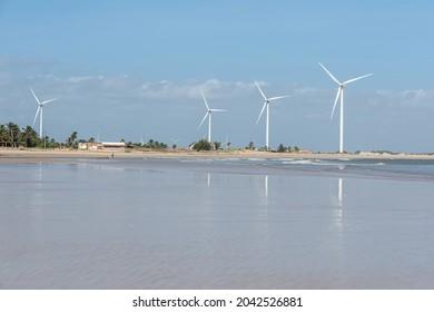 A sunny and hot day at Praia da Pedra do sal in Parnaíba. This beach has a wind farm. Parnaíba city on the coast of Piauí, Brazil. August 2021.