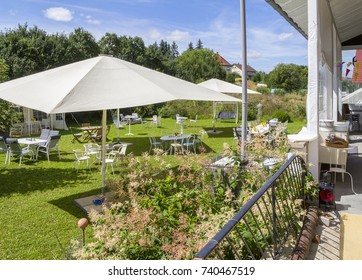 sunny illuminated idyllic scenery showing a garden prepared for party