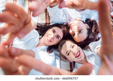 Sunny image of best friend girls taking selfie on camera