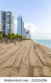 SUNNY ISLES BEACH, USA - AUG 17, 2014: people enjoy and relax near the pier in Sunny Isles Beach, USA. In 1936, Milwaukee malt magnate Kurtis built the Sunny Isles beach and pier.