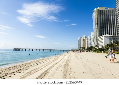 SUNNY ISLES BEACH, USA - JULY 28, 2013: people relax near the pier in Sunny Isles Beach, USA. In 1936, Milwaukee malt magnate Kurtis built Sunny Isles beach and pier.