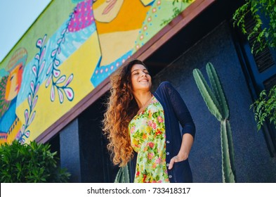 Sunny lifestyle, portrait of the young and elegant hipster woman smiling, wearing trendy clothes, light jacket