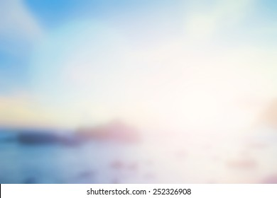 Sunny light pattern concept: Abstract blurred beach sunrise landscape background.