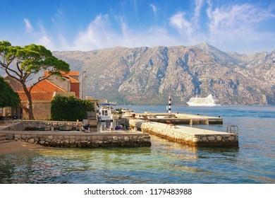 Sunny Mediterranean landscape. Montenegro, Adriatic Sea, Bay of Kotor. View of  Prcanj town
