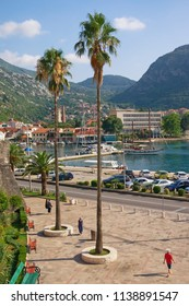 Sunny Mediterranean landscape. Montenegro, Kotor city. View of embankment and square before  Sea (West) Gate of Old Town