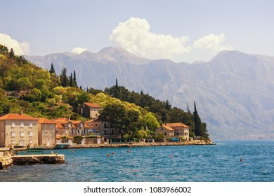 Sunny Mediterranean landscape. Montenegro, view of Bay of Kotor and ancient town of Perast