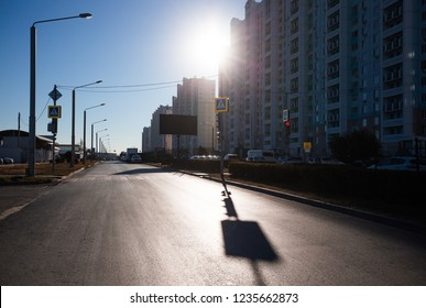 Sunny morning in the city, residential buildings and empty street