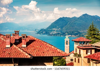 Sunny morning cityscape of Stresa town with Eglise de Vedasco church on background. Colorful summer view of Maggiore lake with Mottarone mountain on background, Italy, Europe.