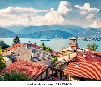 Sunny morning cityscape of Stresa town. Colorful summer view of Maggiore lake with Mottarone mountain on background, Italy, Europe.