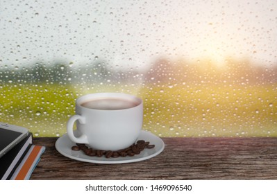 sunny morning with coffee cup on a rainy day window background
