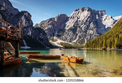 Sunny morning at Famouse Mountain Lake in dolomites Alps. Wonderful Braies Lake during sunrise. Amazing Summer Mountain Landscape. Lago di Braies in Spring, Awesome nature Scenery.  Pragser wildsee
