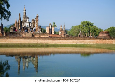 A sunny morning on the ruins of the Buddhist temple of Wat Mahathat. Sukhothai Historical Park, Thailand