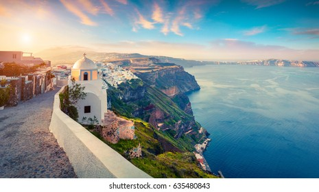 Sunny morning panorama of Santorini island. Picturesque spring sunrise on the famous Greek resort Thira, Greece, Europe. Traveling concept background. Artistic style post processed photo.