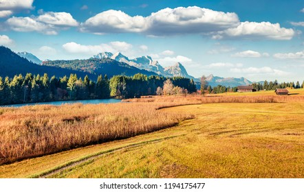 Sunny morning scene of Wagenbruchsee (Geroldsee) lake with Zugspitze mountain range on background. Beautiful autumn view of Bavarian Alps, Germany, Europe. Beauty of nature concept background.