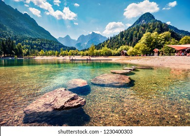 Sunny morning view of Jasna lake. Splendid summer scene of Julian Alps, Gozd Martuljek location, Slovenia, Europe. Wonderful landscape of Triglav National Park. Traveling concept background.