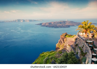 Sunny morning view of Santorini island. Picturesque spring sunrise on the famous Greek resort Fira, Greece, Europe. Traveling concept background. Artistic style post processed photo.