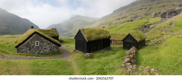 Sunny morning view of typical turf-top houses. Panoramic summer scene of Streymoy island, Denmark, Europe.Torshavn Faroe Islands, Kingdom of Denmark, Europe. Traveling concept background.  - Shutterstock ID 2042562707