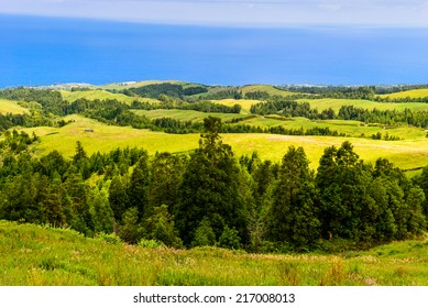 Sunny mountain landscape with blue Atlantic Ocean, Azores, Portugal, Europe