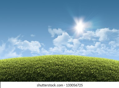 Sunny natural summer background with grassy hill and clear blue sky - great copy-space for posters, cards or banners