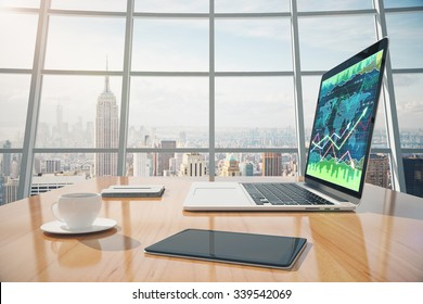 Sunny office with megapolis city view, digital tablet and laptop screen with business chart on the wooden table