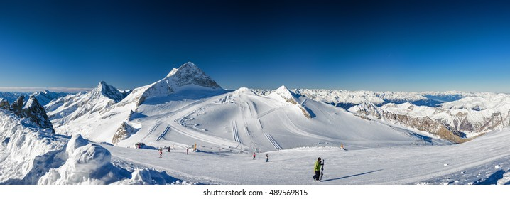 Sunny panoramic view of Austrian Alps from viewpoint of ski resort Zillertal Hintertuxer Glacier, Tirol, Austria.